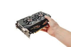Graphic video card in a hand on white Royalty Free Stock Photos