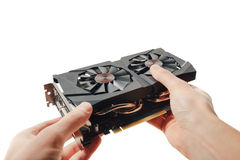 Graphic video card in hands Stock Images