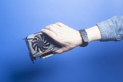 Graphic video card holding hand Royalty Free Stock Images