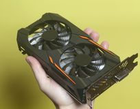 Graphic video card holding hand Royalty Free Stock Photography