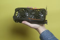 Graphic video card holding hand Stock Images