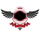 Graphic winged symbol composed with royal crown element and flor Stock Photos