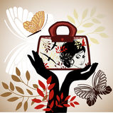 Graphic womans face couture bag. Graphic womans face with foliage, birds and  butterflies - long black gloves Royalty Free Stock Photos