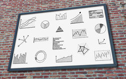 Graphical analysis concept on a billboard. Graphical analysis concept drawn on a billboard fixed on a brick wall Stock Image