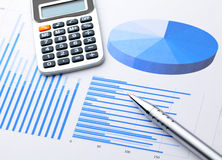 Graphical chart with pen and calculator Royalty Free Stock Photos