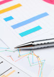 Graphical chart and pen Royalty Free Stock Photos