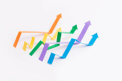Graphics arrows over white background. Photo of business graphics arrows over white background stock photos