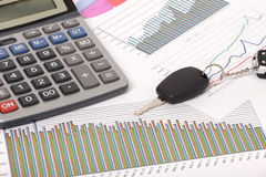 Graphics with calculator and car key Stock Photos