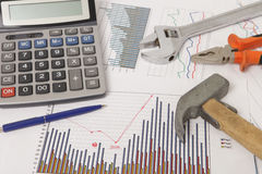 Graphics with calculator and tools Royalty Free Stock Images