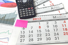 Graphics with calendar and calculator Stock Images