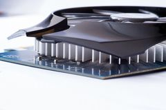 Graphics card with connectors of a different output interfaces and equipped with heat sink without fan on a light. Background Royalty Free Stock Image