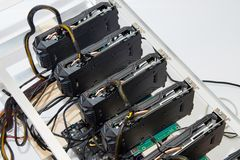 Graphics cards standing in a row in home mining farm. Close-up shot. Cryptocurrency business. Graphics cards standing in a row in home mining farm. Close-up royalty free stock photo