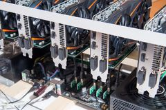 Graphics cards standing in a row in home mining farm. Close-up shot. Cryptocurrency business. Graphics cards standing in a row in home mining farm. Close-up royalty free stock images