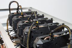 Graphics cards standing in a row in home mining farm. Close-up shot. Cryptocurrency business. Graphics cards standing in a row in home mining farm. Close-up stock image