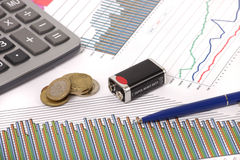 Graphics with pen and battery and coins Stock Photo