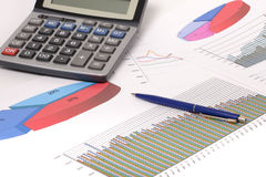 Graphics with pen and calculator Stock Images