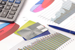 Graphics with pen and calculator Royalty Free Stock Photo