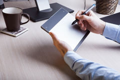 A graphics tablet is on the table Stock Photo