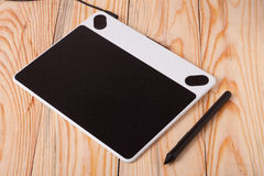Graphics tablet on wooden background Royalty Free Stock Photos