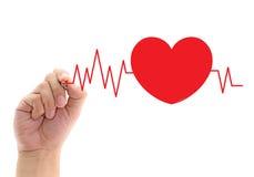 Graphique de battement de coeur de dessin sur l'écran avec un stylo Photographie stock libre de droits