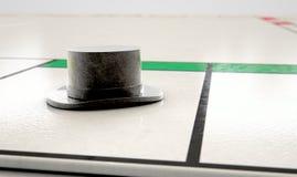 Graphisme de chapeau sur un Boardgame Photo stock