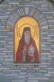 Graphisme religieux sur le mur d'église Photos stock