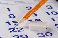 Graphite pencil over calendar. Pencil over slightly defocused calendar background Stock Photography