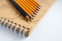 Graphite pencils on a notebook. Pencil drawing. Black and yellow stock photos