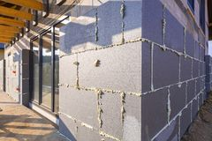 Graphite styrofoam insolation on the new house. Under construction Royalty Free Stock Images