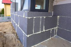 Graphite styrofoam insolation on the new house. Under construction Stock Image