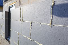 Graphite styrofoam insolation on the new house. Under construction Royalty Free Stock Image