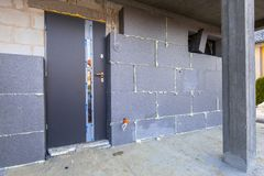 Graphite styrofoam insolation on the new house. Under construction Stock Photos