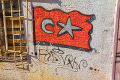 Graphite Turkey flag. ISTANBUL, TURKEY - SEPTEMBER 28, 2013: Graphite Turkey flag on the wall of an old abandoned building in Phanar district stock photos