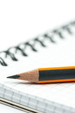 Graphite wooden pencil on the school notebook with blurred backg. Round Royalty Free Stock Image