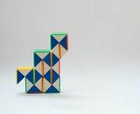 Graphs bars twist Toy. White background Stock Image