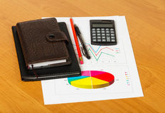 Graphs and business accessories Royalty Free Stock Photo