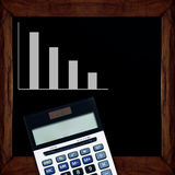 Graphs and Calculator on blackboard. Stock Image