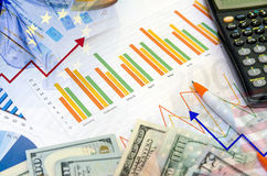 Graphs and Calculator, pen and money Stock Photo