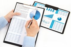 Graphs and charts analyzed. By businessman Stock Photography