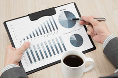 Graphs and charts analyzed. By businessman Stock Image