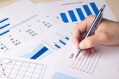 Graphs and charts analyzed by businessman Royalty Free Stock Images