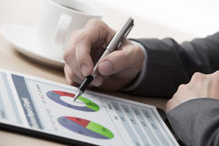 Graphs and charts analyzed by businessman Stock Images