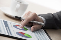 Graphs and charts analyzed by businessman Royalty Free Stock Photography