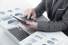 Graphs and charts analyzed by businessman. On table Stock Images