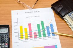 Graphs, charts, business table with money, calculator and pen. On table Royalty Free Stock Photo