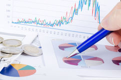 Graphs, charts, business table. The workplace of business people. Stock Photos