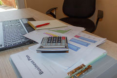 Graphs, charts, business table. The workplace of business people. Computer laptop, calculator, business chart, close up Royalty Free Stock Photography