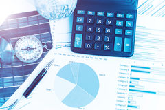 Graphs, charts, calculator, pen, compass on business table. The Stock Photo