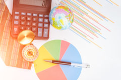 Graphs, charts, calculator, pen, compass on business table. The Royalty Free Stock Images