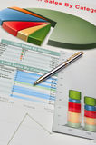 Graphs and charts. Colorful financial schedules and charts on a desktop of the businessman Stock Images